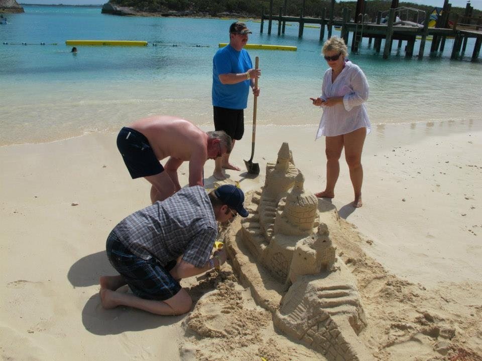 Employees make some sand castle