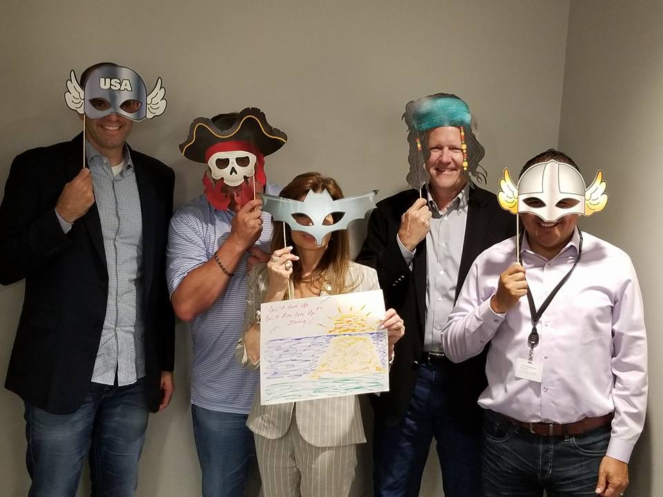 Employees masquerade picture taking during the leaders meeting